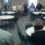 We join in a circle of prayer to God before the fish fry opens.